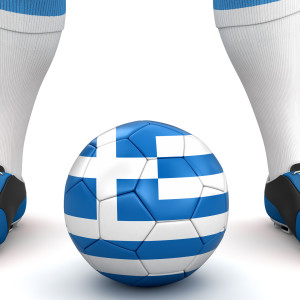 Man and soccer ball  with Greek flag. Image with clipping path