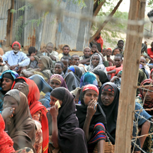 DADAAB SOMALIA - AUGUST 7: Unidentified women and men live in the Dadaab refugee camp hundreds of thousands of Somalis wait for help because of hunger on August 7 2011 in Dadaab Somalia.