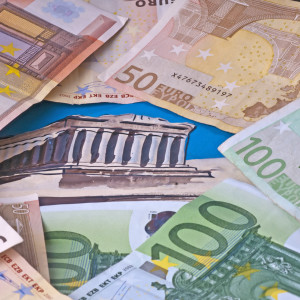 euro crisis in Greek with euro bank notes and the Akropolis building