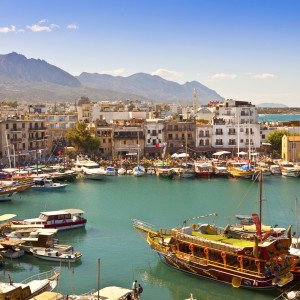 KYRENIA, CYPRUS - OCTOBER 6: Scenic view of a busy historic harbour and the old town in Kyrenia (Girne) October 6, 2013 the Island of Cyprus.