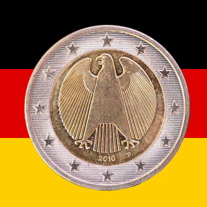 A two euros coin from Germany with the national german flag as background