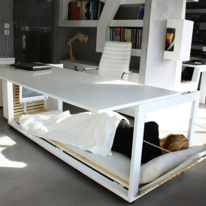 "It is the dream of many office workers - the chance for a quick nap.   Now a design firm has unveiled this desk with its own in-built BED. Side panels fold out to reveal a mattress and a headboard. The so-called 'Nap Desk' - officially titled '1, 6 S.m. of Life' - is the brainchild of Greek company, Studio NL. Designer Athanasia Leivaditou said: ""The main concept was to comment on the fact that many times our lives are 'shrinking' in order to fit into the confined space of our office. ""Eventually I realized that each civilization may have a very different perception of things depending on its social context.  ""For example this desk could be used for a siesta, or in interiors where there is lack of space or for a few hours of sleeping at night between deadlines."" The desk is two meters long and 0.8 meters wide and made of metal, lacquered wood and solid wood and white leather.  It won the Silver A' Design Award. There are no immediate plans to make it commercially available.  *Mandatory credit Splash News/Studio NL*   Pictured: Desk has its own bed Ref: SPL1133145  240915   Picture by: Splash News/Studio NL  Splash News and Pictures Los Angeles: 310-821-2666 New York: 212-619-2666 London: 870-934-2666 photodesk@splashnews.com"