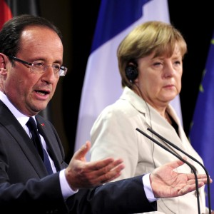 German Chancellor Angela Merkel (R) and the new French president Francois Hollande arrive to address a press conference at the German Chancellery on May 15, 2012 in Berlin. Francois Hollande meets Angela Merkel for their first talks on the debt crisis as Greece's future in the eurozone appears uncertain before giving a news conference and sharing a working dinner. AFP PHOTO / JOHN MACDOUGALL