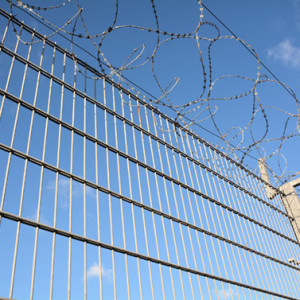 Barbed wire on top of a fence to protect against burglars