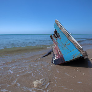 old longtail boat of fisherman clash on beach