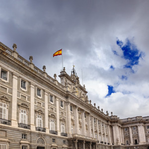 OCTOBER 25, 2012-MADRID, SPAIN Royal Palace Palacio Real Clouds Sky Spanish Flag Madrid Spain on October 25, 2012.