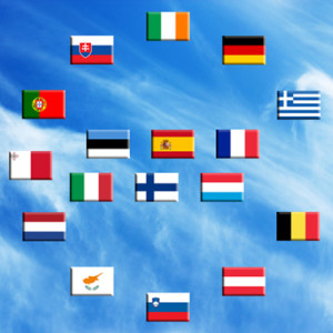 Flags of eurozone countries against the sky and clouds
